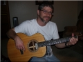 Kevin playing the guitar he built.jpg